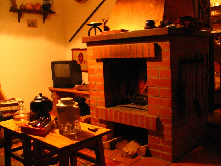 The fireplace in a friend's cosy mountain cabin where we spend many cosy winter nights and happy summers