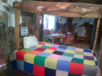 Inside the shoe is a small bedroom inspired by the story of the old lady who raised her kids in a shoe.